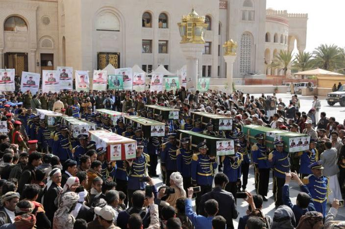 FILE PHOTO: Honour guards carry coffins of Houthi fighters killed in recent fighting against government forces in Yemen's oil-rich province of Marib, during a funeral procession in Sanaa
