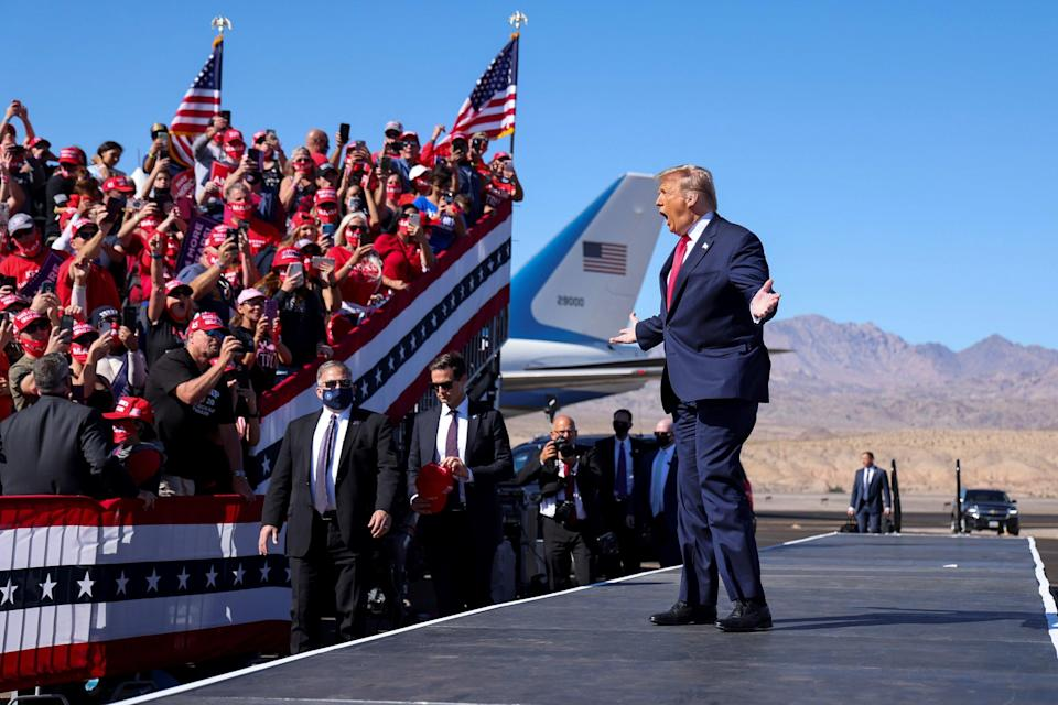 President Donald Trump gestures towards supporters as he arrives for a campaign rally at Laughlin/Bullhead International Airport in Bullhead City, Arizona, on Wednesday. (REUTERS)