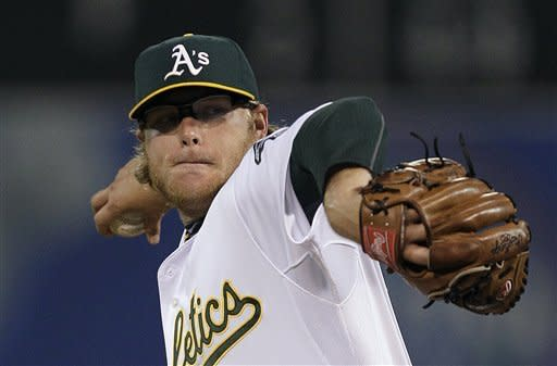 Oakland Athletics' A.J. Griffin works against the Seattle Mariners in the first inning of a baseball game Friday, Sept. 28, 2012, in Oakland, Calif. (AP Photo/Ben Margot)