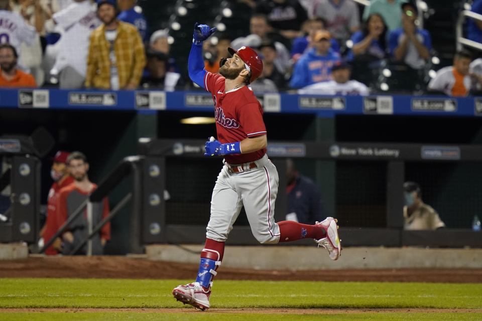 Philadelphia Phillies' Bryce Harper gestures as he runs the bases after hitting a home run during the sixth inning of the second baseball game of a doubleheader against the New York Mets Friday, June 25, 2021, in New York. (AP Photo/Frank Franklin II)