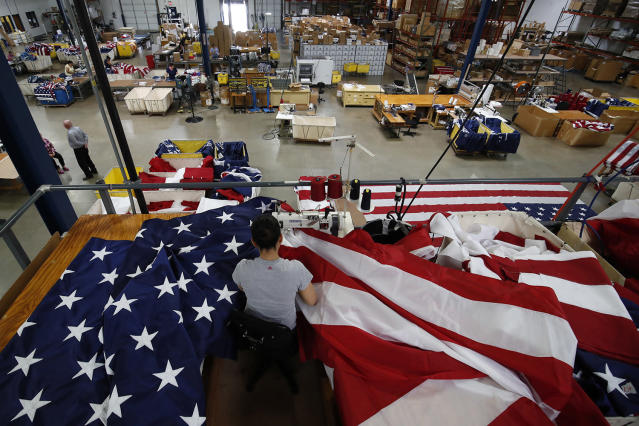 <p>A worker sews an American flag at the FlagSource facility in Batavia, Illinois, U.S., on Tuesday, June 27, 2017. (Photo: Jim Young/Bloomberg via Getty Images) </p>