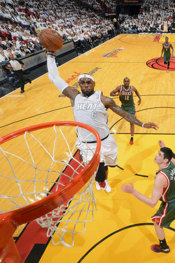 MIAMI, FL - APRIL 21: LeBron James #6 of the Miami Heat goes up for a dunk against the Milwaukee Bucks in Game One of the Eastern Conference Quarterfinals during the 2013 NBA Playoffs on April 21, 2013 at the American Airlines Arena in Miami, Florida. (Photo by Jesse D. Garrabrant/NBAE via Getty Images)