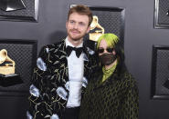 Finneas O'Connell, left, and Billie Eilish arrive at the 62nd annual Grammy Awards at the Staples Center on Sunday, Jan. 26, 2020, in Los Angeles. (Photo by Jordan Strauss/Invision/AP)