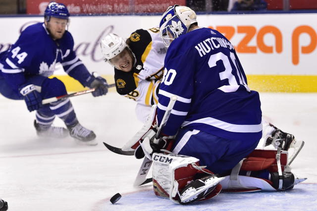 Toronto Maple Leafs goaltender Michael Hutchinson (30) stops Boston Bruins right wing David Pastrnak (88 during the third period of an NHL hockey game, Saturday, Jan. 12, 2019 in Toronto. (Frank Gunn/The Canadian Press via AP)