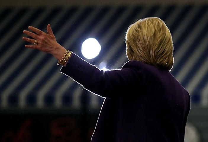 """<p>Hillary Clinton, who narrowly defeated Vermont Sen. Bernie Sanders in the Iowa caucuses, speaks at a """"get out the vote"""" event at Winnacunnet High School, in Hampton, N.H. <i>(Photo: Justin Sullivan/Getty Images)</i></p>"""