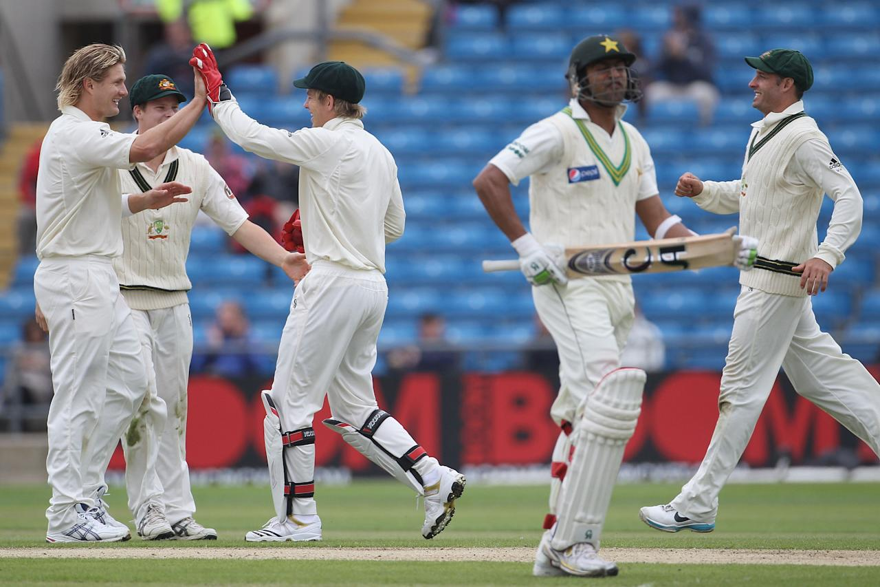 LEEDS, ENGLAND - JULY 22:  Shane Watson of Australia celebrates the wicket of Shoaib Malik of Pakistan with team mates during day two of the 2nd Test between Pakistan and Australia played at Headingley Carnegie Stadium on July 22, 2010 in Leeds, England.  (Photo by Hamish Blair/Getty Images)