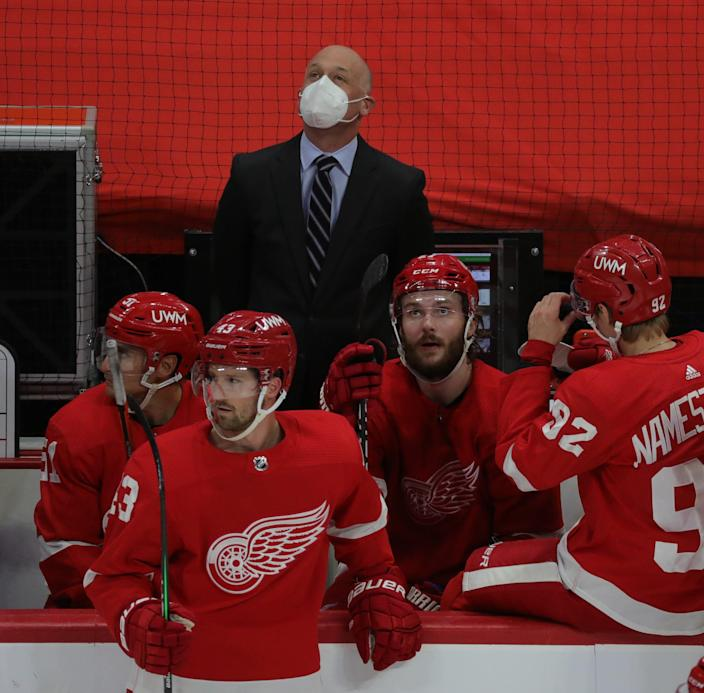 Red Wings coach Jeff Blashill looks at the scoreboard in the second period on Thursday, April 15, 2021, at Little Caesars Arena.