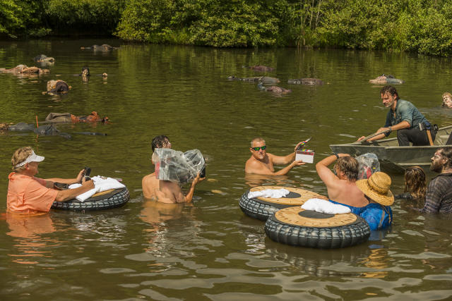 <p><em>TWD</em> crew show just how dedicated they are as they get right into the water while filming a boat scene with Andy Lincoln in Season 7's midseason finale.<br><br>(Photo: AMC) </p>