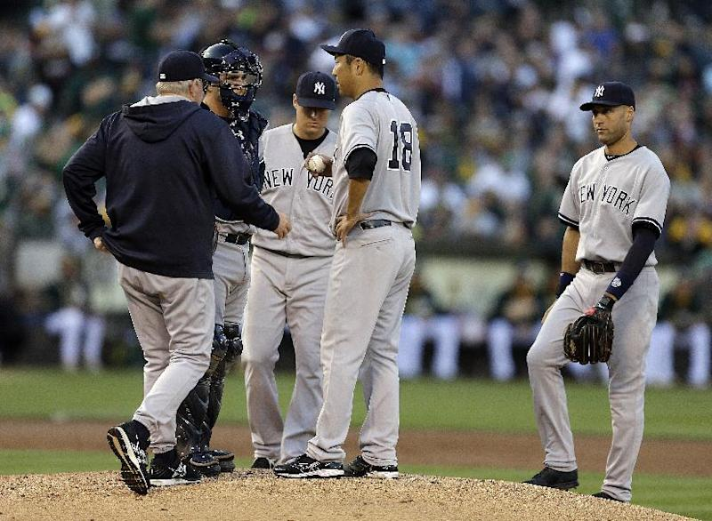 A's, Yankees game resumes after light delay