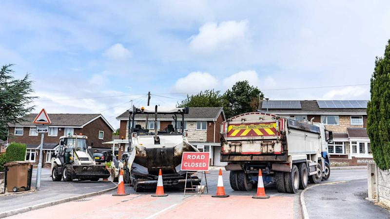 Road closed as workers repair potholes
