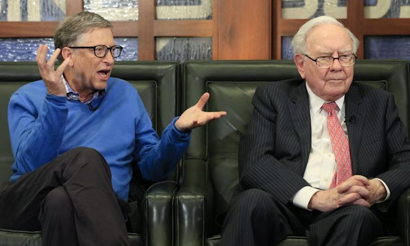 Berkshire Hathaway Chairman and CEO Warren Buffett, right, and Bill Gates, Microsoft co-founder and director at Berkshire Hathaway, sit together