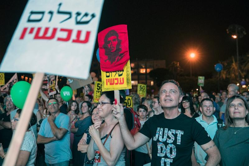 Israeli left-wing supporters in Tel Aviv's Rabin Square demonstrate against 50 years of occupation of Palestinian land on May 27, 2017 (AFP Photo/JACK GUEZ)