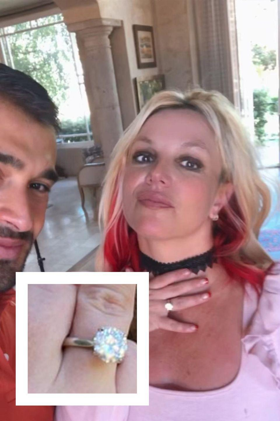"""<p>On September 12, 2021, Britney Spears shared the news of her engagement to longtime boyfriend, Sam Ashgari. The pop star <a href=""""https://www.instagram.com/p/CTvOjVsMPJe/"""" rel=""""nofollow noopener"""" target=""""_blank"""" data-ylk=""""slk:posted a sweet video"""" class=""""link rapid-noclick-resp"""">posted a sweet video</a> of herself and Ashgari, who is an actor and fitness trainer, with an enthusiastic """"I can't fucking believe it 💍💍💍💍💍💍❣️!!!!!!"""" as the caption. The ring, by Forever Diamonds NY, is a custom four-carat, round-cut diamond with a platinum cathedral setting. According to a statement from the jeweler, the inside of the silver band is engraved with the word """"Lioness,"""" Ashgari's nickname for Spears.</p>"""