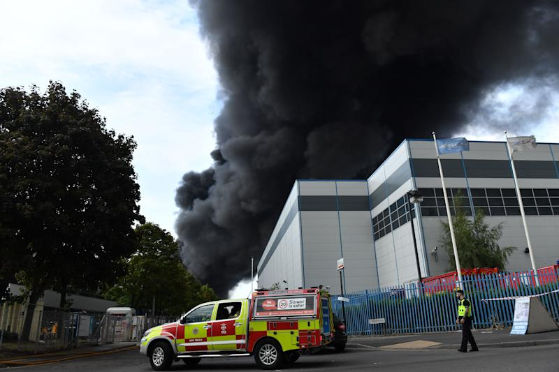 Smoke at the scene of a severe blaze as crews from 10 fire engines tackle a large fire on an industrial estate in Birmingham. (Photo: PA)