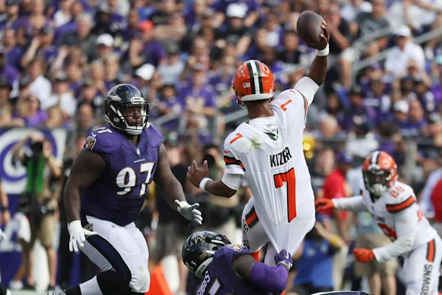 <p>Outside linebacker Terrell Suggs #55 of the Baltimore Ravens tries to take down quarterback DeShone Kizer #7 of the Cleveland Browns in the four quarter at M&T Bank Stadium on September 17, 2017 in Baltimore, Maryland. (Photo by Rob Carr /Getty Images) </p>