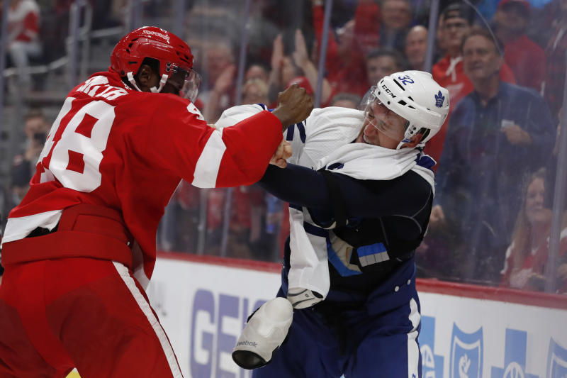 Detroit Red Wings left wing Givani Smith (48) and Toronto Maple Leafs center Tyler Gaudet (32) fight during the third period of an NHL hockey preseason game, Friday, Sept. 27, 2019, in Detroit. (AP Photo/Carlos Osorio)