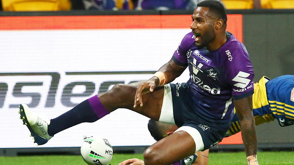 Ex-Melbourne Storm star Suliasi Vunivalu is pictured after scoring a try in the NRL.