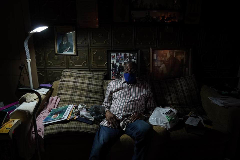 Carleton Smith sits on the couch of his mother's home in St. Louis on Friday, May 21, 2021. Smith, a cousin of Craig Elazer, found him dead after a fentanyl overdose in September. He looked through the mail slot and saw him lying there. (AP Photo/Brynn Anderson)
