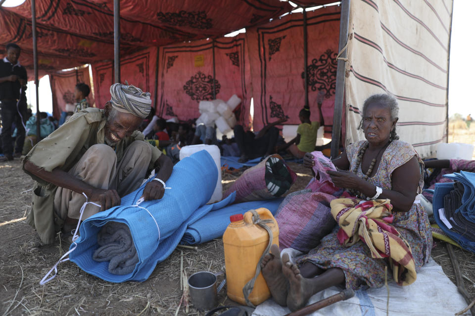 Ethiopian refugees rest in Qadarif region, easter Sudan, Wednesday, Nov 18, 2020. The U.N. refugee agency says Ethiopia's growing conflict has resulted in thousands fleeing from the Tigray region into Sudan as fighting spilled beyond Ethiopia's borders and threatened to inflame the Horn of Africa region. (AP Photo/Marwan Ali)