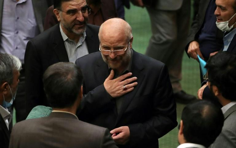 Iranian Mohammad-Bagher Ghalibaf (C) stands among members of parliament after being elected speaker