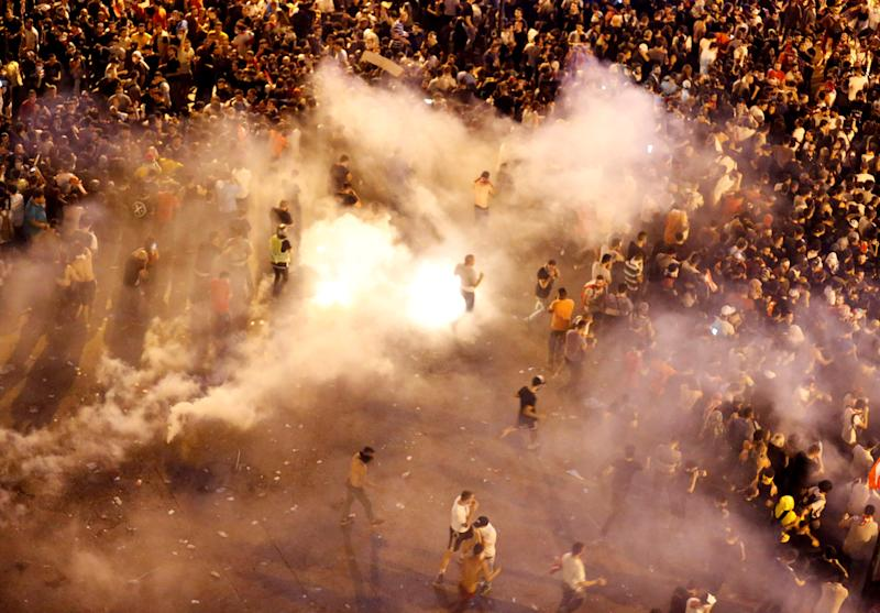 Riot police fire tear gas in Beirut, Lebanon
