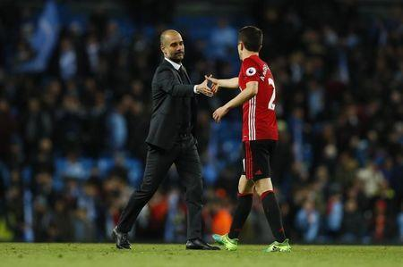 Britain Soccer Football - Manchester City v Manchester United - Premier League - Etihad Stadium - 27/4/17 Manchester City manager Pep Guardiola Manchester United's Ander Herrera at the end of the match Action Images via Reuters / Jason Cairnduff Livepic