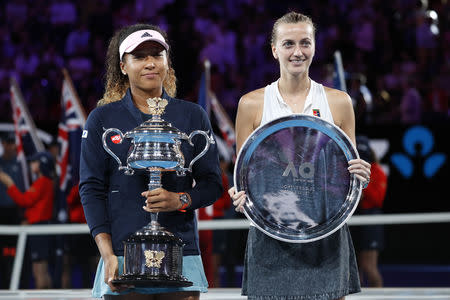 Tennis - Australian Open - Women's Singles Final - Melbourne Park, Melbourne, Australia, January 26, 2019. Japan's Naomi Osaka and Czech Republic's Petra Kvitova pose with their trophies. REUTERS/Kim Kyung-Hoon