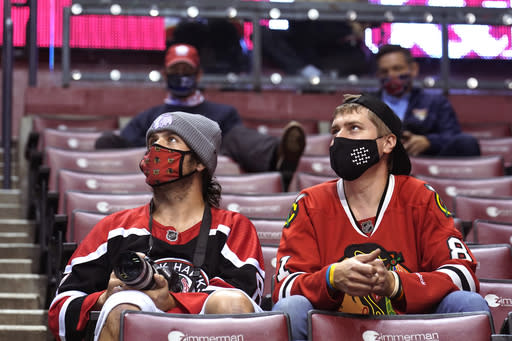 Chicago Blackhawk fans watch during the second period of the team's NHL hockey game against the Florida Panthers on Tuesday, Jan. 19, 2021, in Sunrise, Fla. The Panthers allow a limited number of fans to attend their games. Not only are the Panthers still unbeaten after two games just the sixth time in the franchises 27-year history that has happened but theyre also leading the NHL in attendance. (AP Photo/Marta Lavandier)
