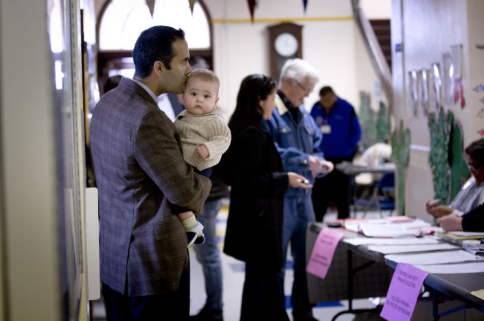 George P. Bush, kisses his son Prescott, as he turned out to vote in the primary election Tuesday, March 4, 2014, at North High Mount Elementary School in Fort Worth, Texas. The 37-year-old nephew of former President George W. Bush, and son of former Florida Gov. Jeb Bush, is running for land commissioner in the state. (AP Photo/The Fort Worth Star-Telegram, Joyce Marshall) MAGS OUT; (FORT WORTH WEEKLY, 360 WEST)