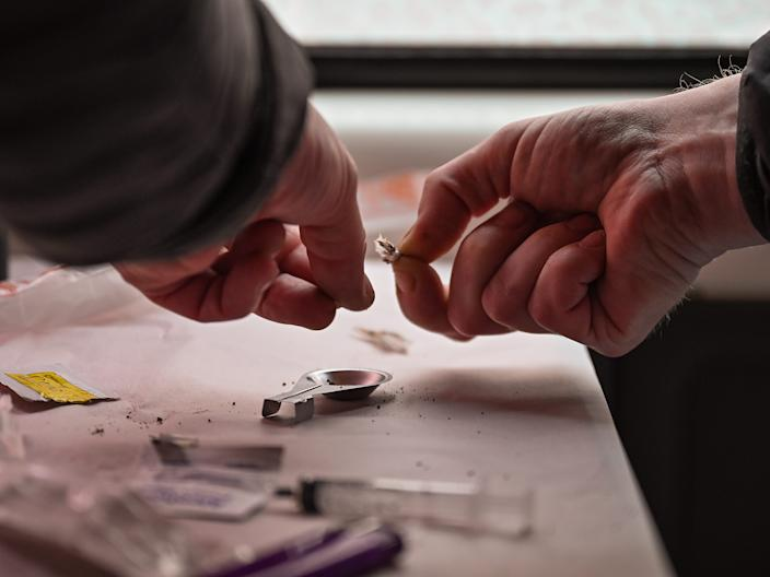 A drug user prepares heroin before injecting inside of a Safe Consumption van on September 25, 2020 in Glasgow, Scotland.