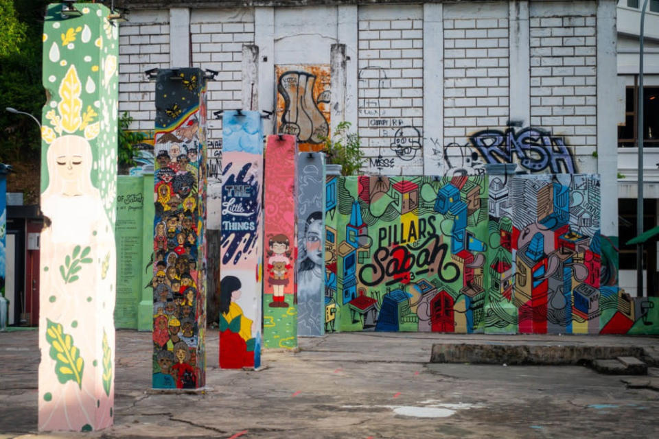 The Pillars of Sabah before the artworks were wiped off with white paint. — Borneo Post Online pic
