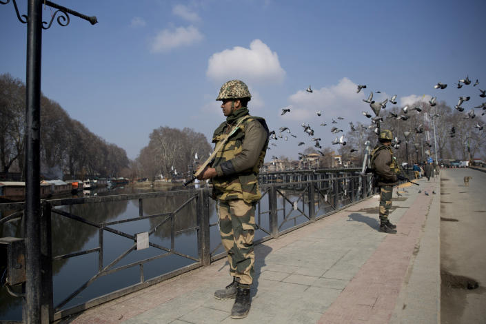 Indian paramilitary soldiers stand guard on a deserted street during a strike in Srinagar, Indian controlled Kashmir, Sunday, Feb. 3, 2019. India's prime minster is in disputed Kashmir for a daylong visit Sunday to review development work as separatists fighting Indian rule called for a shutdown in the Himalayan region. (AP Photo/Dar Yasin)