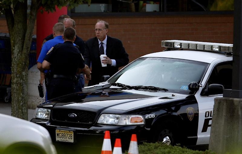 Middlesex County prosecutor Bruce Kaplan, right, arrives at the scene of a shooting at a Pathmark grocery store in Old Bridge, N.J., Friday, Aug. 31, 2012. At least three people have died in the shooting. A law enforcement official briefed on the shooting says the person believed to be the shooter is among the dead. (AP Photo/Julio Cortez)