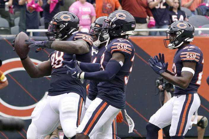 Chicago Bears defensive tackle Bilal Nichols celebrates his fumble recovery with teammates during the first half of an NFL football game against the Detroit Lions Sunday, Oct. 3, 2021, in Chicago. (AP Photo/David Banks)