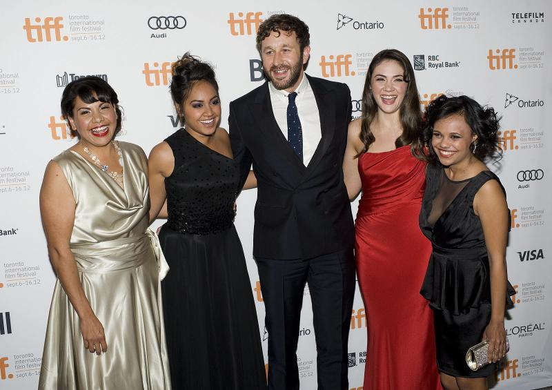 "FILE - In this Sept. 9, 2012 file photo, Deborah Mailman, from left, Jessica Mauboy, Chris O'Dowd, Shari Sebbens and Miranda Tapsell pose for a photo on the red carpet at the Elgin Theatre for the film ""The Sapphires"" during the 2012 Toronto International Film Festival in Toronto. Feel-good musical drama ""The Sapphires"" sparkled at Australia's premier film awards.  The tale of an Aboriginal family singing group entertaining American troops in the Vietnam War won best film and five other awards at the Australian Academy of Cinema and Television Arts ceremony Wednesday night, Jan. 30, 2013. Best Lead Actress Mailman and Best Supporting Actress Mauboy won for playing sisters in the group and O'Dowd won the lead actor award for playing the group's talent manager.  (AP Photo/The Canadian Press, Aaron Vincent Elkaim, File)"
