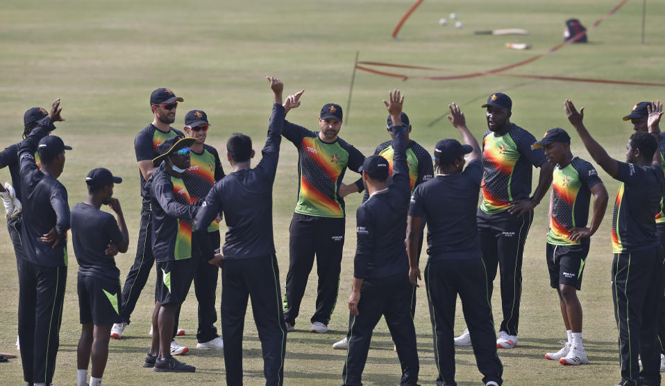 The Zimbabwe cricket team attend a meeting prior to practice session at the Pindi Cricket Stadium, in Rawalpindi, Pakistan, Thursday, Oct. 29, 2020. The Zimbabwe cricket team is in Pakistan to play three ODIs and three Twenty20 International match series, beginning with the first ODI on Friday. (AP Photo/Anjum Naveed)