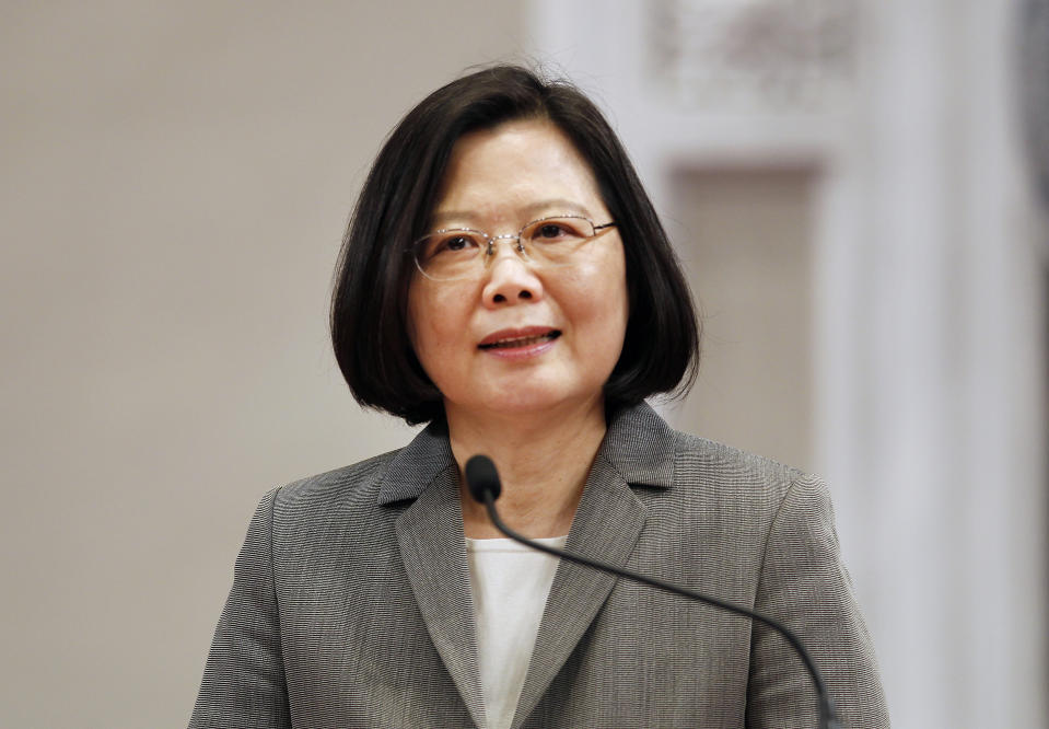 Taiwan's President Tsai Ing-wen answers to press during a media event at the Presidential Office in Taipei, Taiwan, Wednesday, April 11, 2018. (AP Photo/Chiang Ying-ying)