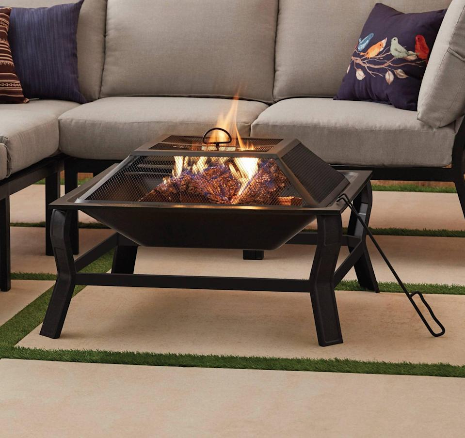 <p>The modern yet outdoorsy look of this <span>Mainstays Greyson Square Wood-Burning Fire Pit</span> ($67) will give your backyard a subtle upgrade.</p>