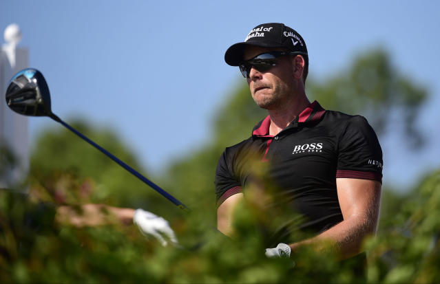 Sweden's Henrik Stenson watches after hitting from the fourth tee during the last round of the Hero World Challenge at Albany Golf Club in Nassau, Bahamas, Sunday, Dec. 2, 2018. (AP Photo/Dante Carrer)