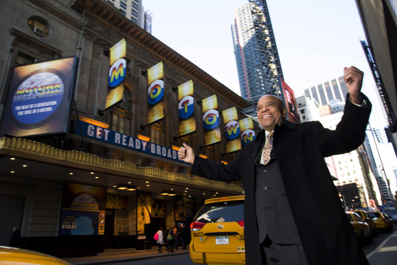 """This March 5, 2013 photo shows Berry Gordy posing for a portrait in front of the Lunt-Fontanne Theatre in New York.  For Berry Gordy, conquering Broadway is the next - and by his own admission, last - major milestone of a magical, musical career. The 83-year-old Motown Records founder is taking his story and that of his legendary label to the Great White Way. """"Motown: The Musical,"""" opens for previews Monday. (Photo by Charles Sykes/Invision/AP)"""