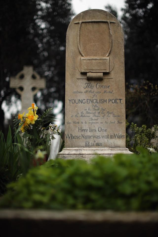 ROME, ITALY - MARCH 26: The gravestone of poet John Keats, (1795-1821), stands in Rome's 'Non Catholic Cemetery' on March 26, 2013 in Rome, Italy. John Keats, one of England's most famous poets died early in 1820 of tuberculosis aged 25, after travelling to Italy in search of a better climate to help cure him of the disease. Rome's Non-Catholic Cemetery contains one of the highest densities of famous and important graves anywhere in the world. It is the final resting-place of the poets Percy Shelley and John Keats, as well as many other painters, sculptors and authors who died in Rome. The cemetery which began it's use in 1730 continues today, containing graves of Orthodox Christians, Jews, Muslims and other non-Christians, and is one of the oldest burial grounds in Europe. (Photo by Dan Kitwood/Getty Images)