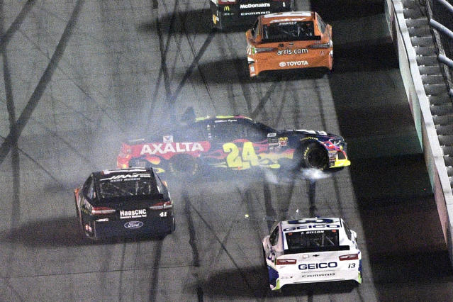 "<a class=""link rapid-noclick-resp"" href=""/nascar/sprint/drivers/3791/"" data-ylk=""slk:William Byron"">William Byron</a> (24) loses control of his car before tapping the wall on the front stretch during the first of two qualifying races for the Daytona 500 at Daytona International Speedway Thursday, Feb. 15, 2018, in Daytona Beach, Fla. (AP Photo/Phelan M. Ebenhack)"
