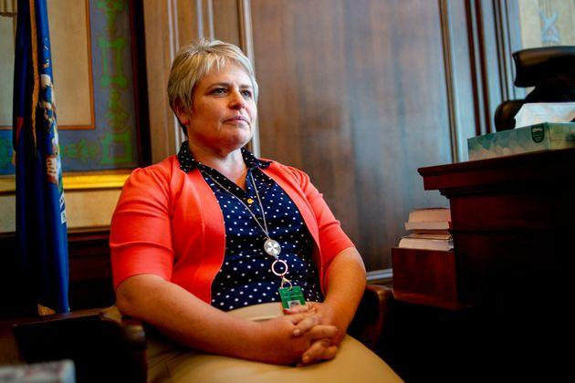 Shiawassee County Commissioner Marlene Webster testifies during a show cause hearing on Monday after commissioners voted on bonus payments to themselves. That vote is accused of violating the state's Open Meetings Act. (Photo: via Associated Press)