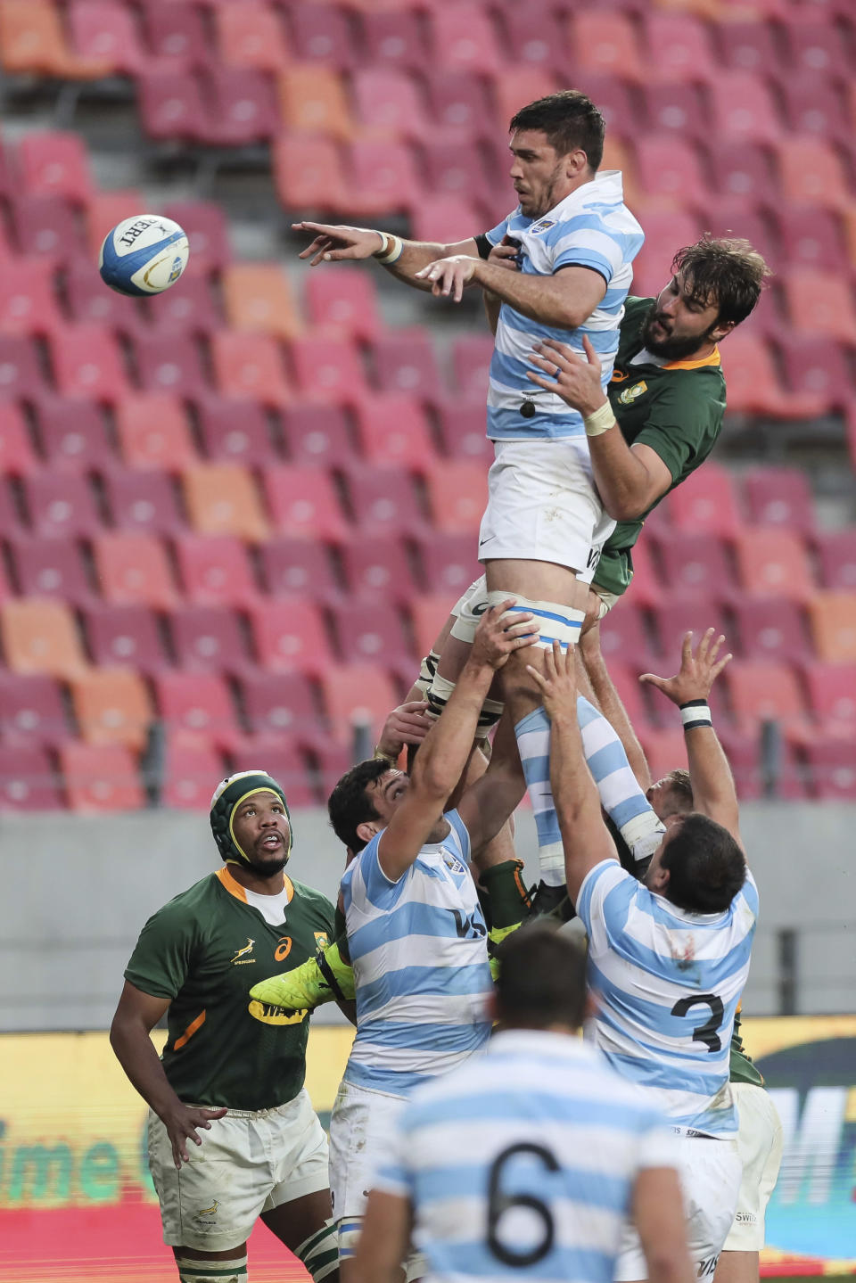 Rodrigo Bruni of Argentina, left, is challenged by Franco Mostert of South Africa in a line out during the second Rugby Championship match between Argentina and South Africa at the Nelson Mandela Bay Stadium, Gqebeha, South Africa, Saturday, Aug. 21, 2021. (AP Photo/Halden Krog)