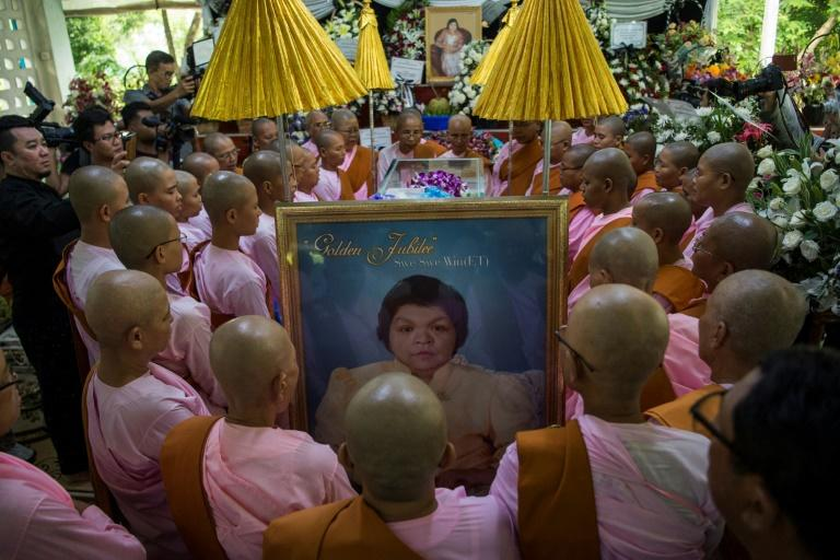 Buddhist nuns pray during the funeral of  Myanmar fortune-teller Swe Swe Win, known as ET
