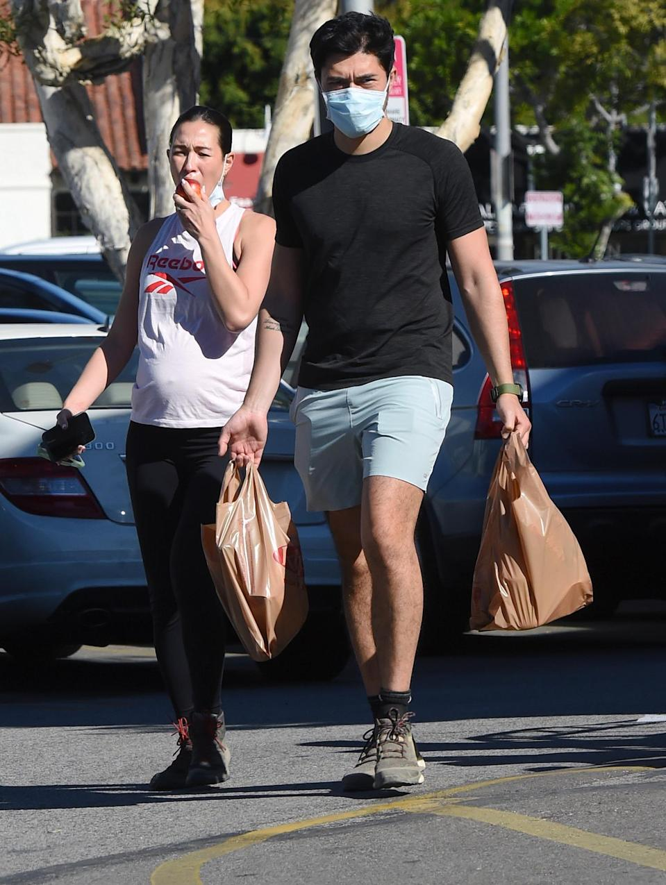 <p>Parents-to-be Henry Golding and Liv Lo go grocery shopping at Ralph's after enjoying a hike with friends in L.A. on Monday.</p>