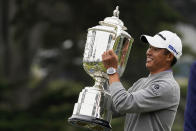 Collin Morikawa holds the Wanamaker Trophy after winning the PGA Championship golf tournament at TPC Harding Park Sunday, Aug. 9, 2020, in San Francisco. (AP Photo/Charlie Riedel)