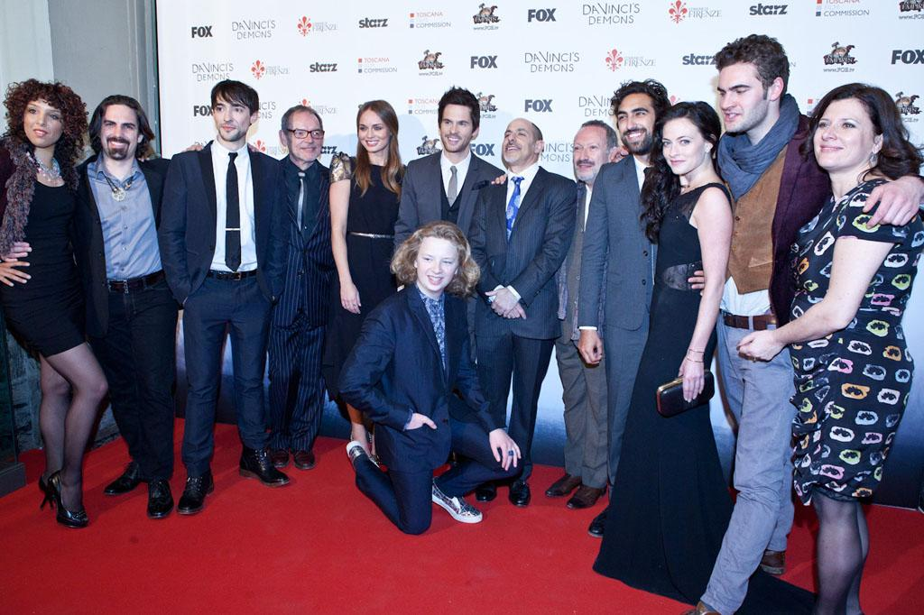 """The cast and producers of """"Da Vinci's Demons"""" attend the world premiere screening at the Cinema Teatro Odeon in Florence, Italy on April 2. Left to right: Singer Raya Yarbough, composer Bear McCreary, Blake Ritson, David Schofield, Laura Haddock, Tom Riley (Da Vinci), creator/producer David S. Goyer, Allan Corduner, Gregg Chillin, Lara Pulver, Tom Bateman, executive producer Julie Gardner and seated Eros Vlahos."""