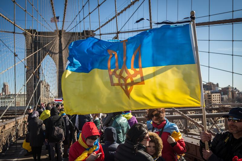Hundreds march across the Brooklyn Bridge to demonstrate solidarity with protestors killed during the Ukrainian revolution of 2014.