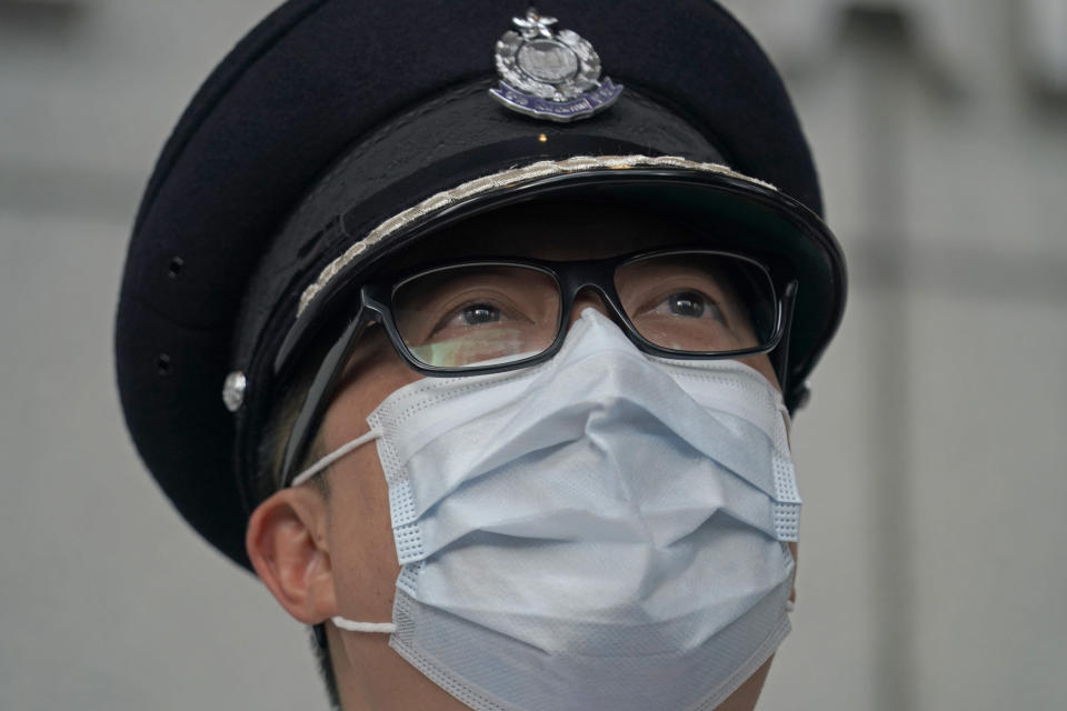Chris Tang, commissioner of the Hong Kong Police Force, speaks during a press conference in Hong Kong, Wednesday, May 12, 2021. A top Hong Kong national security officer was reportedly caught up in a raid on an unlicensed massage business, and will face a police force investigation into the alleged misconduct. Hong Kong's Director of National Security Frederic Choi has since been put on leave after the incident, according to Tang. (AP Photo/Kin Cheung)
